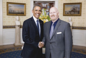 Brett Bigham with President Barack Obama. Photo courtesy the White House Press Office
