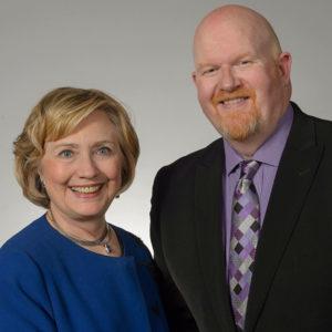 Brett Bigham with Sen. Hilary Clinton. Photo courtesy the Clinton Foundation